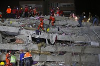 Members of rescue services search in the debris of a collapsed building for survivors in Izmir, Turkey, early Oct. 31, 2020. (AP Photo/Emrah Gurel)