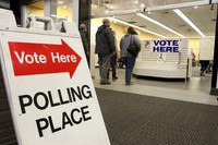 Residents in Anchorage, Alaska, take part in early voting in a mall in Alaska's largest city on Oct. 30, 2020. (AP Photo/Mark Thiessen)