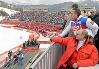 In this file photo taken on March 8, 2014, Russian President Vladimir Putin, foreground, and Russia's sports minister Vitaly Mutko, standing behind, watch a downhill ski competition at the 2014 Winter Paralympics in Roza Khutor mountain district of Sochi, Russia. (Alexei Nikolsky, Sputnik, Kremlin Pool Photo via AP)