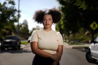 Amira Temple, a contact tracer for the COVID-19 virus, stands for a portrait, on Oct. 22, 2020, in Chula Vista, Calif. (AP Photo/Gregory Bull)