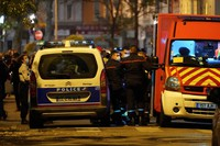 Police officers and rescue workers block the access to the scene after a Greek Orthodox priest was shot, on Oct.31, 2020, while he was closing his church in the city of Lyon, central France. (AP Photo/Laurent Cipriani)