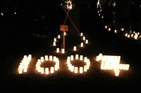 Candles are arranged to spell out