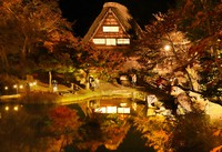 The Gasshozukuri Minkaen Outdoor Museum, which includes buildings with a traditional Gassho-style steep rafter roof is seen amid the autumn colors and lit up by a special light show, in Shirakawa, Gifu Prefecture. (Mainichi/Tadayuki Otake)
