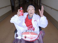 Kane Tanaka, the world's oldest living person, is seen with a bottle of coke in her hand following confirmation she had broken the record for the longest-lived Japanese person, on Sept. 25, 2020, in Higashi Ward in the city of Fukuoka, in this image provided by Coca-Cola Bottlers Japan Inc.