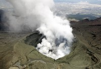 Mount Aso's crater spews volcanic smoke in this photo taken in Kumamoto Prefecture from a Mainichi Shimbun helicopter in April 2019.