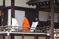 In this photo provided by the Imperial Household Agency of Japan, Japan's Crown Prince Akishino, second from left, walks for a ceremony after he was formally proclaimed the first in line to the Chrysanthemum Throne at the Imperial Palace in Tokyo, Sunday, Nov. 8, 2020. (Imperial Household Agency of Japan via AP)
