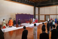 In this photo provided by the Imperial Household Agency of Japan, Japan's Crown Prince Akishino, second from left, flanked by his wife Crown Princess Kiko, left, attends a ceremony for formally proclaims Akishino is the first in line to the Chrysanthemum Throne with Emperor Naruhito, center left, and Empress Masako, center right, at the Imperial Palace in Tokyo, Sunday, Nov. 8, 2020. (Imperial Household Agency of Japan via AP)