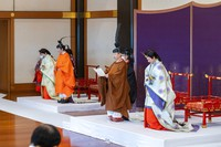 In this photo provided by the Imperial Household Agency of Japan, Japan's Crown Prince Akishino, in orange robe, flanked by his wife Crown Princess Kiko, second from left, attends a ceremony for formally proclaims Akishino is the first in line to the Chrysanthemum Throne, with Emperor Naruhito, second from right, and Empress Masako, right, at the Imperial Palace in Tokyo, Sunday, Nov. 8, 2020. (Imperial Household Agency of Japan via AP)