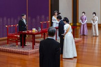 In this photo provided by the Imperial Household Agency of Japan, Japan's Crown Prince Akishino, center, and his wife Crown Princess Kiko, center right, meet Emperor Naruhito, left, and Empress Masako, second from left, during a ceremony after Akishino was formally proclaimed the first in line to the Chrysanthemum Throne, at the Imperial Palace in Tokyo, Sunday, Nov. 8, 2020. (Imperial Household Agency of Japan via AP)