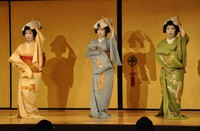 Geisha are seen performing traditional dance to the piece