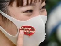 A mask is seen decorated with a sticker distributed by staffers at Universal Studios Japan in Osaka's Konohana Ward on Nov. 12, 2020. (Mainichi/Naohiro Yamada)