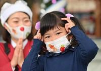 A girl wears a mask decorated with stickers distributed by staffers at Universal Studios Japan in Osaka's Konohana Ward on Nov. 12, 2020. (Mainichi/Naohiro Yamada)