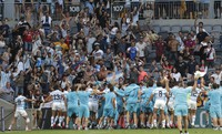 Argentina players wave to their supporters as they celebrate after the Tri-Nations rugby test between Argentina and New Zealand at Bankwest Stadium, Sydney, Australia, Saturday, Nov.14, 2020. (AP Photo/Rick Rycroft)