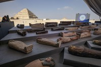 People look at ancient sarcophagi on display, discovered in a vast necropolis in Saqqara, Giza, Egypt, on Nov. 14, 2020. (AP Photo/Nariman El-Mofty)