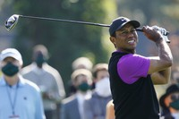 Tiger Woods follows his ball after teeing off at the first hole during the third round of the Masters golf tournament, on Nov. 14, 2020, in Augusta, Ga. (AP Photo/Charlie Riedel)