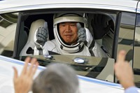 Japan Aerospace Exploration Agency astronaut Soichi Noguchi gives the thumbs up to family members as he leaves the Operations and Checkout Building with fellow crew members for a trip to Launch Pad 39A and planned liftoff on a SpaceX Falcon 9 rocket with the Crew Dragon capsule on a six-month mission to the International Space Station Sunday, Nov. 15, 2020, at the Kennedy Space Center in Cape Canaveral, Fla. (AP Photo/John Raoux)