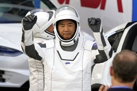 Japan Aerospace Exploration Agency astronaut Soichi Noguchi reacts as he leaves the Operations and Checkout Building with fellow crew members for a trip to Launch Pad 39A and planned liftoff on a SpaceX Falcon 9 rocket with the Crew Dragon capsule on a six-month mission to the International Space Station, on Sunday, Nov. 15, 2020, at the Kennedy Space Center in Cape Canaveral, Fla. (AP Photo/John Raoux)