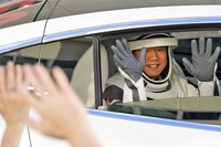 Japan Aerospace Exploration Agency astronaut Soichi Noguchi waves to family members as he leaves the Operations and Checkout Building with fellow crew members for a trip to Launch Pad 39A and planned liftoff on a SpaceX Falcon 9 rocket with the Crew Dragon capsule on a six-month mission to the International Space Station Sunday, Nov. 15, 2020, at the Kennedy Space Center in Cape Canaveral, Fla. (AP Photo/John Raoux)