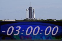 The countdown clock is stopped at a three-hour built-in hold as a SpaceX Falcon 9 rocket, with the company's Crew Dragon capsule attached, sits on the launch pad at Launch Complex 39A Sunday, Nov. 15, 2020, at the Kennedy Space Center in Cape Canaveral, Fla. (AP Photo/Chris O'Meara)