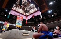 Banners promoting coronavirus preventive measures are shown to spectators during a break at the November Grand Sumo Tournament at Tokyo's Ryogoku Kokugikan sumo venue, on Nov. 9, 2020. (Mainichi/Toshiki Miyama)