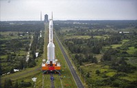 In this Nov. 17, 2020, photo released by China's Xinhua News Agency, a Long March-5 rocket is moved at the Wenchang Space Launch Site in Wenchang in southern China's Hainan Province. (Guo Cheng/Xinhua via AP)