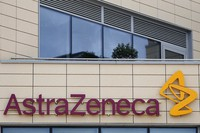 In this July 18, 2020, file photo, AstraZeneca offices and its corporate logo are seen in Cambridge, England. (AP Photo/Alastair Grant)