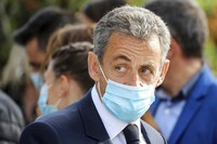 In this Oct. 29, 2020 file photo, former French President Nicolas Sarkozy attends a ceremony in Nice, southern France. (Valery Hache; Pool via AP)