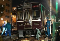 The first carriage of a train that derailed after colliding with a lightweight van at a crossing on the Hankyu Kobe Line is seen in Kobe's Nada Ward on Nov. 23, 2020. (Mainichi/Rei Kubo)