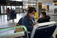Esmeralda Elizalde checks in for her flight to Mexico at the Los Angeles International Airport in Los Angeles, on Nov. 23, 2020. (AP Photo/Jae C. Hong)