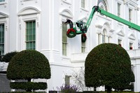 A worker hangs holiday wreaths on the White House on Nov. 21, 2020, in Washington. (AP Photo/Jacquelyn Martin)
