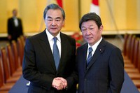 In this Nov. 25, 2019, file photo, Chinese Foreign Minister Wang Yi, left, poses with his Japanese counterpart Toshimitsu Motegi for a photo prior to a meeting in Tokyo. (Behrouz Mehri/Pool Photo via AP)