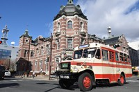 A retro 1960's style bus is seen running on a street in front of The Bank of Iwate's historical red-brick building in the city of Morioka. (Mainichi/Maika Hyuga)