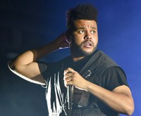 The Weeknd performs on day three at Lollapalooza in Chicago on Aug 4, 2018.  (Photo by Rob Grabowski/Invision/AP)