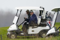 U.S. President Donald Trump drives a golf cart as he golfs at Trump National Golf Club in Sterling, Virginia, on Nov. 22, 2020. (AP Photo/Manuel Balce Ceneta)