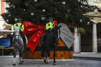 Two police officers ride their horses while backdropped by a Christmas tree in Covent Garden, in London, on Nov. 24, 2020. (AP Photo/Alberto Pezzali)