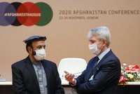 Afghanistan's Economy Minister Abdul Hadi Arghandiwal, left, and Finland's Foreign Minister Pekka Haavisto talk during the plenary session of the 2020 Afghanistan Conference at the United Nations in Geneva, Switzerland, on Nov. 24, 2020. (Denis Balibouse/Pool Photo via AP)