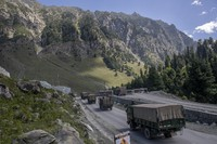 In this Sept. 9, 2020 file photo, an Indian army convoy moves on the Srinagar-Ladakh highway at Gagangeer, northeast of Srinagar in Indian-controlled Kashmir. (AP Photo/ Dar Yasin)