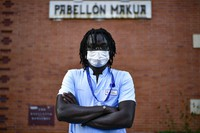 Mbaye Babacar Diouf, poses for a photo wearing his nurse's uniform, at Basurto hospital, in Bilbao, northern Spain, on Nov. 18, 2020. (AP Photo/Alvaro Barrientos)