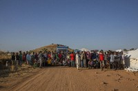 Tigray refugees who fled the conflict in Ethiopia's Tigray region, are ordered to organize themselves in line to receive aid at Umm Rakouba refugee camp in Qadarif, eastern Sudan, on Nov. 24, 2020. (AP Photo/Nariman El-Mofty)