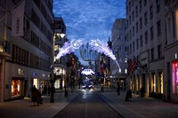Christmas lights are lit up on New Bond Street in Mayfair, London, on Nov. 24, 2020. (AP Photo/Alberto Pezzali)