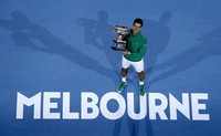 In this Feb. 3, 2020 file photo, Serbia's Novak Djokovic holds the Norman Brookes Challenge Cup after defeating Austria's Dominic Thiem in the men's singles final of the Australian Open tennis championship in Melbourne, Australia. (AP Photo/Andy Wong)