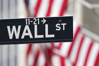A street sign is displayed at the New York Stock Exchange in New York, on Nov. 23, 2020. (AP Photo/Seth Wenig)
