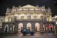 In this Oct. 25, 2020 file photo, a military vehicle drives past La Scala opera theater in Milan, northern Italy. (AP Photo/Luca Bruno)