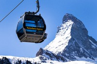 In this March 18, 2020 file photo, a view of a 'Matterhorn-Express' gondola lift in front of Matterhorn mountain in the Zermatt ski resort, in Zermatt, Switzerland. (Jean-Christophe Bott/Keystone via AP)