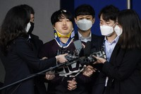 In this March 25, 2020 file photo, Cho Ju-bin, center, leader of South Korea's online sexual blackmail ring which is so called