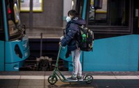 A pupil drives by a subway train in Frankfurt, Germany, on Nov. 25, 2020. (AP Photo/Michael Probst)