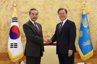 South Korean President Moon Jae-in, right, poses with Chinese Foreign Minister Wang Yi for a photo before a meeting at the presidential Blue House in Seoul, South Korea, on Nov. 26, 2020. (Kim Ju-sung/Yonhap via AP)