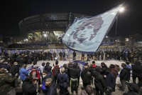 People gather outside the San Paolo Stadium to pay their homage to soccer legend Diego Maradona, in Naples, Italy, on Nov. 25, 2020. (AP Photo/Salvatore Laporta)