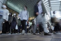 A train station passageway is crowded with commuters wearing face masks during rush hour in Tokyo on Nov. 20, 2020. (AP Photo/Eugene Hoshiko)