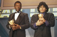 In this March 1987 file photo, Pele, left, and Diego Maradona, hold trophies during an awards ceremony in Italy. (AP Photo)